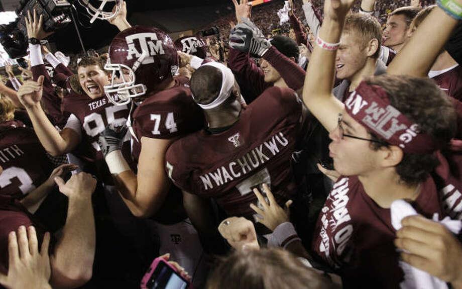 Aggies basketball coach Mark Turgeon caught football fever during Texas A&M's win over Nebraska. Photo: Karen Warren, Chronicle