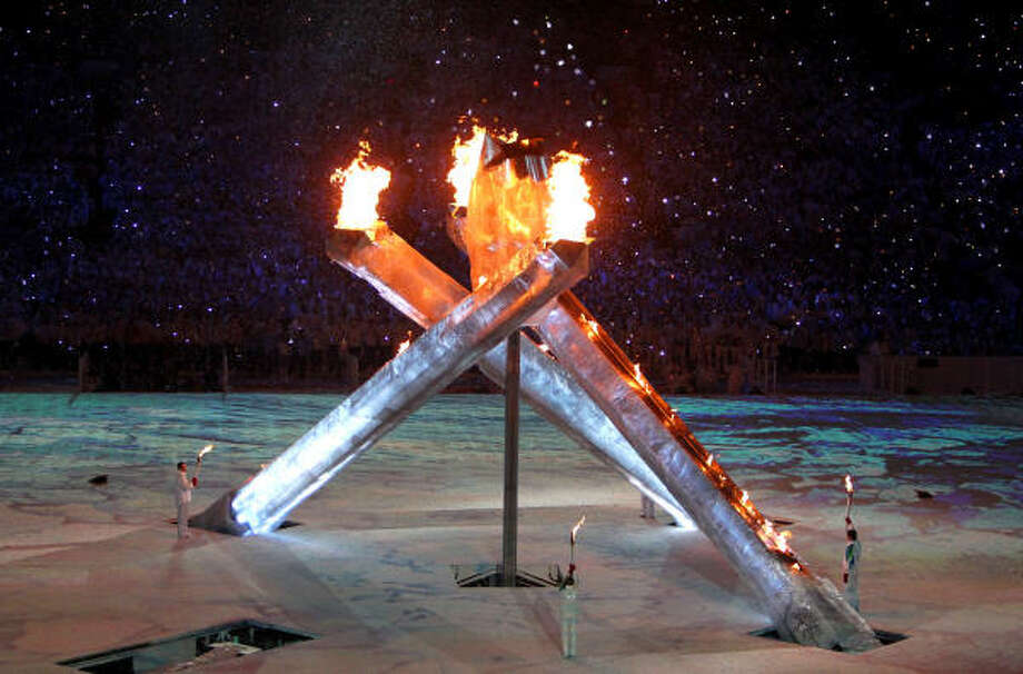 The Olympic flame was lit on a day overshadowed by the death of luger Nodar Kumaritashvili. Photo: Smiley N. Pool, Chronicle