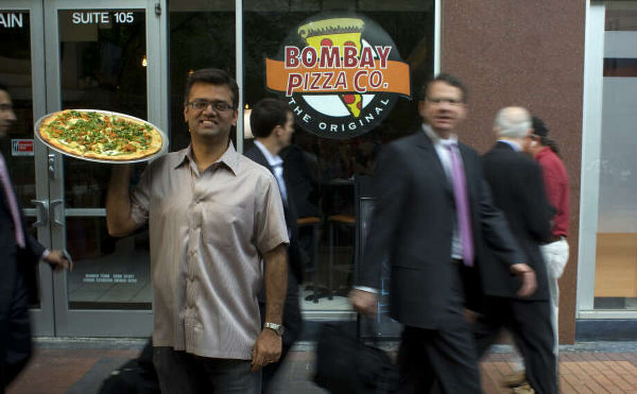 Viral Patel, owner of Bombay Pizza Co., an Indian-Italian fusion restaurant downtown, is pumped about his pies. Photo: Johnny Hanson, Chronicle