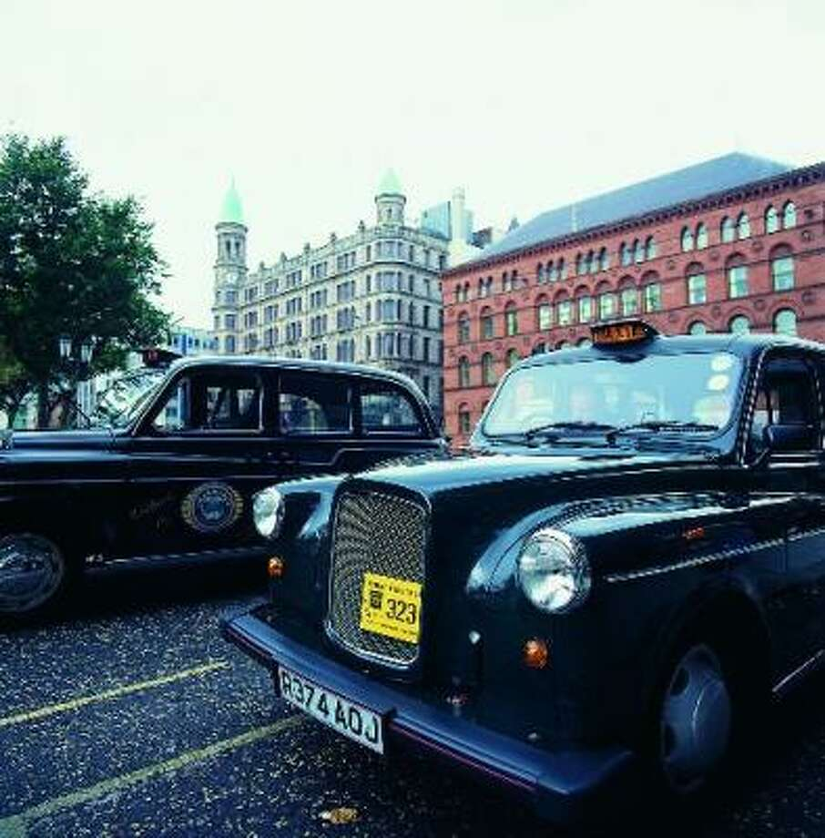 The Black Taxis of Belfast, now mostly devoted to tourism, grew out of a serious local need. During the height of The Troubles, safe passage had to be arranged via taxi, and the taxi drivers themselves could only operate within, never across, each neighborhood's boundaries. Photo: BELFAST VISITOR & CONVENTION BUREAU
