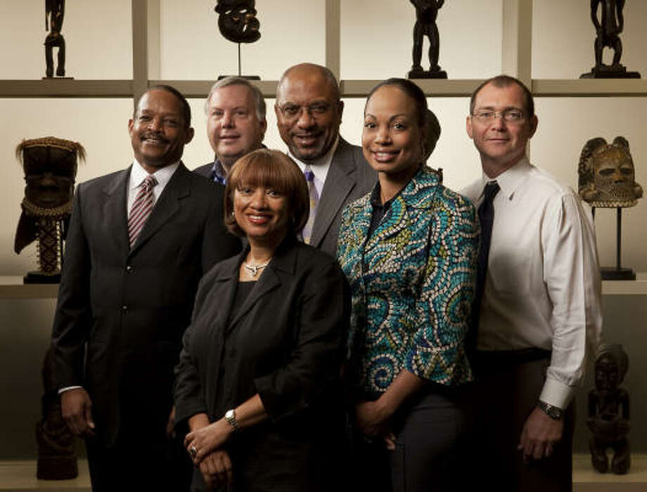 At Houston accounting firm McConnell, Jones, Lanier and Murphy are partner Wayne McConnell, left, principal Edward Hlousek, partner Sharon Murphy, partner Thomas Jones, principal Tene Thomas and principal Rance Buss.  Photo: Nathan Lindstrom :, For The Chronicle
