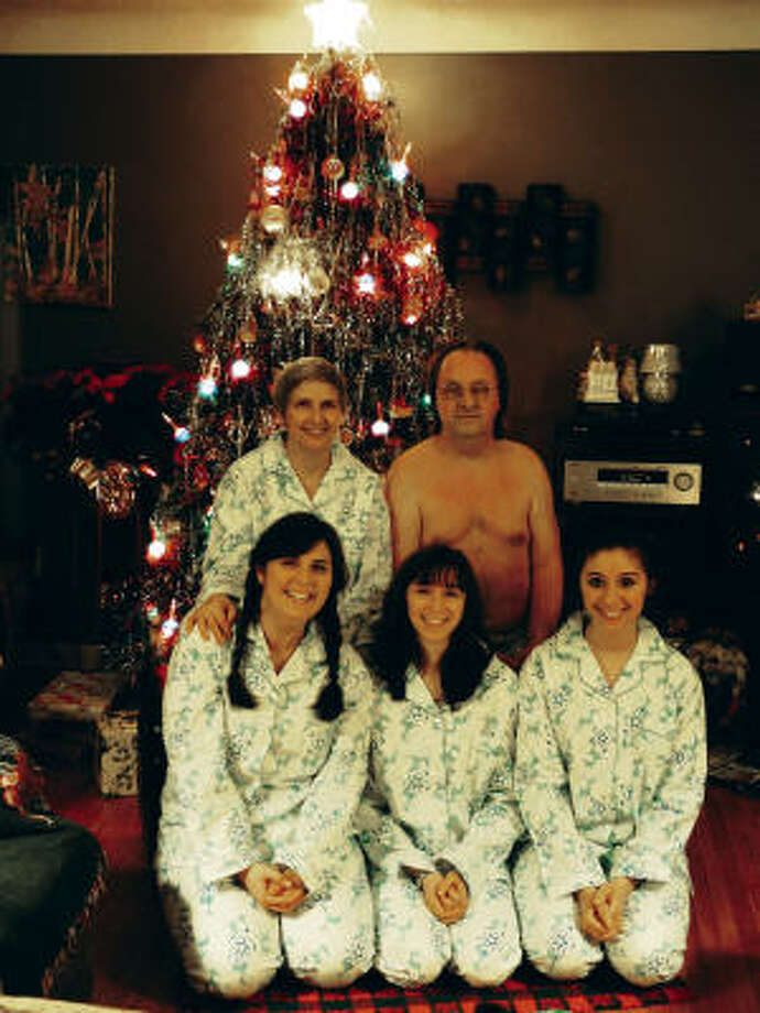 It looks like Santa forgot to deliver Dad's matching set of pajamas on Christmas Day. Better luck next year. Photo: From AWKWARD FAMILY PHOTOS