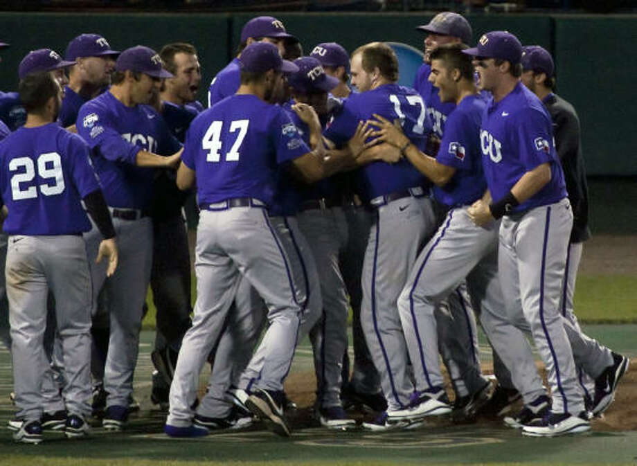 TCU's Matt Curry (17) is mobbed at home plate after he hit a grand slam against Florida State in the eighth inning. Photo: Nati Harnik, AP