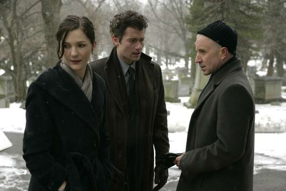 Jessica Collins, James Badge Dale and Arliss Howard, right, star in Rubicon. Photo: AP