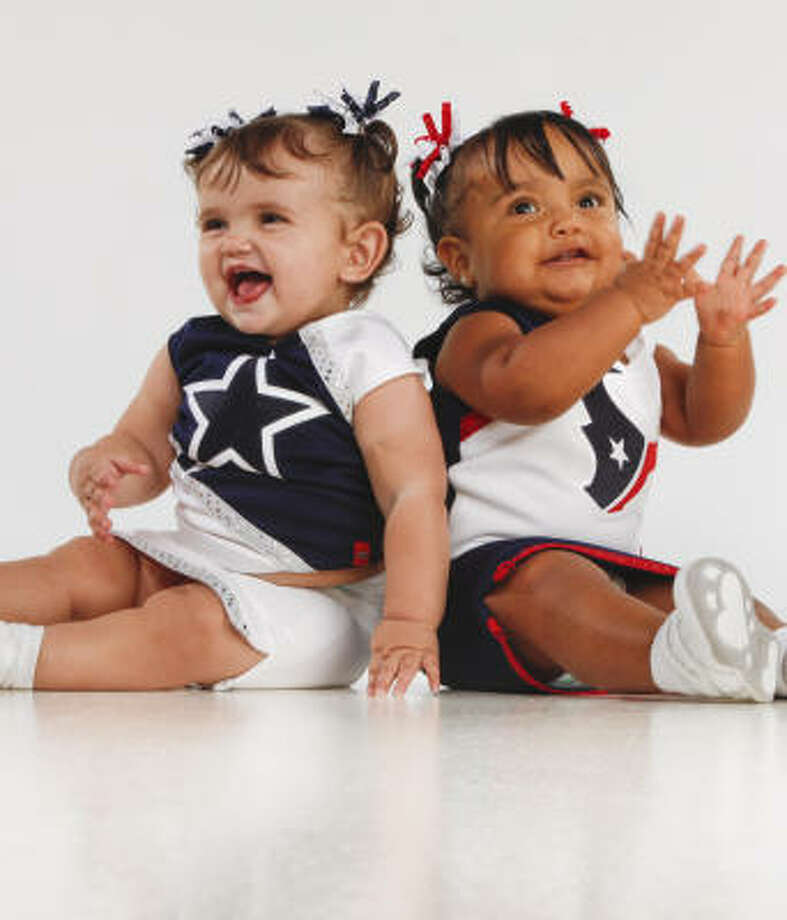 Tess Getman, 10½ months, plays the role of Cowboys fan to 1-year-old Amina Rubio's Texans fan. Uniforms by The Sew Factory. Photo: Smiley N. Pool, Chronicle