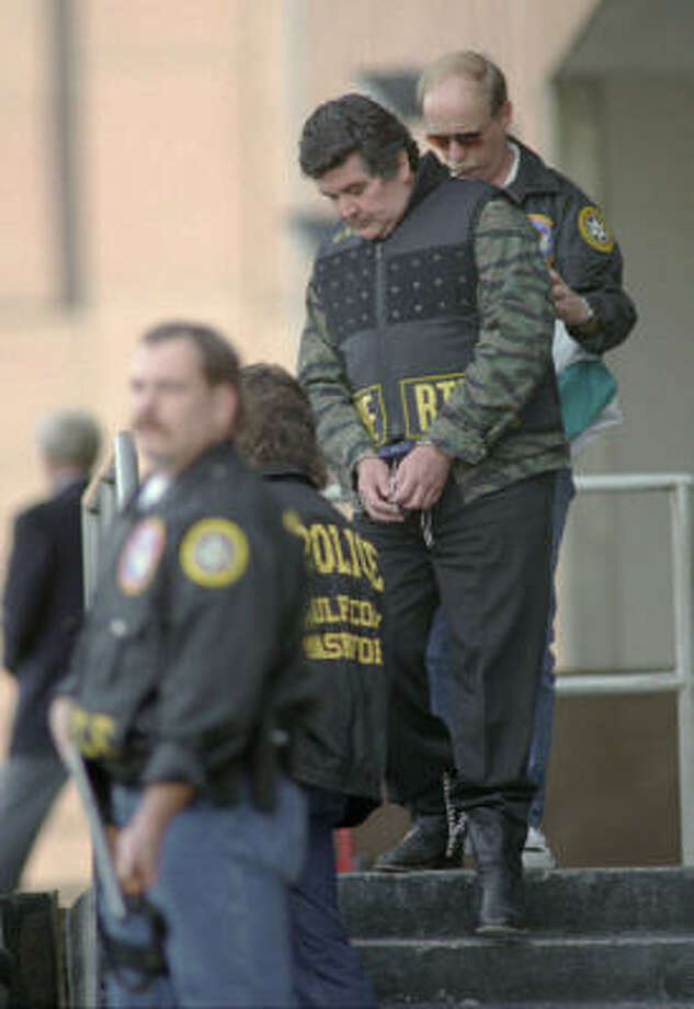 Juan Garcia Abrego, shown being escorted from the federal courthouse in 1996, was sentenced to 11 life terms, largely on the strength of testimony from a Mexican police commander who had been paid $1 million. Photo: BRETT COOMER, Chronicle