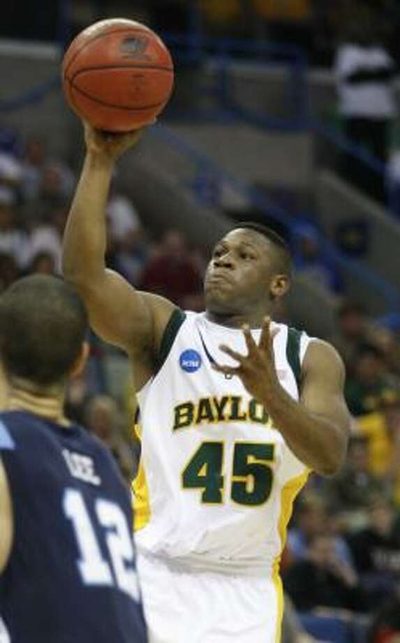 Baylor guard Tweety Carter shoots over Old Dominion forward Gerald Lee. Photo: Patrick Semansky, AP