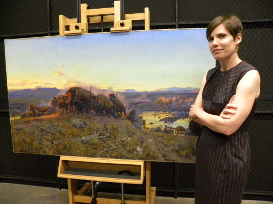 Erica James' grandfather kept Charles M. Russell's 1914 masterpiece When the Land Belonged to God in his apartment after a fire broke out at the painting's original home, the Montana Club in Helena. Photo: Douglas Britt, Chronicle