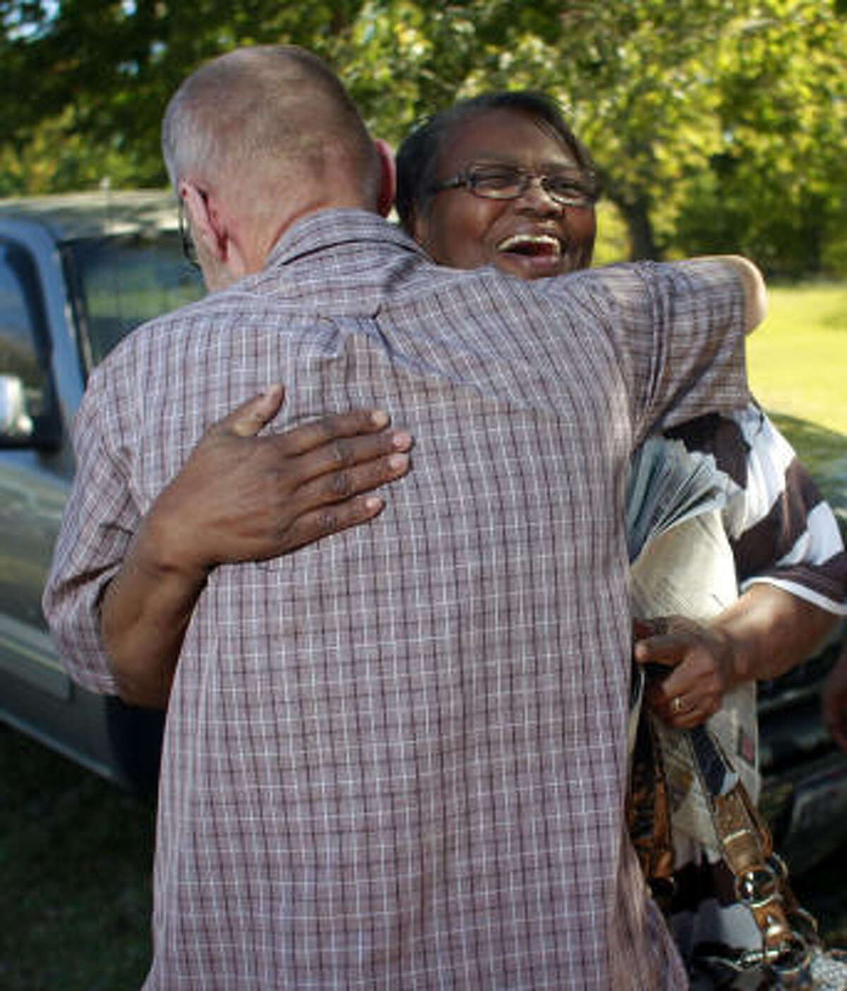 """Graves' mother, Doris Curry, greets Lars Ake Augustsson, a supporter of her son, at a celebration in Brenham on Saturday. Augustsson, an activist from Stockholm, Sweden, became friends with Graves in 1999. """"We realized very early that this was a flimsy case,"""" he said. Augustsson wrote a book, Close to Death, about Texas' death row."""