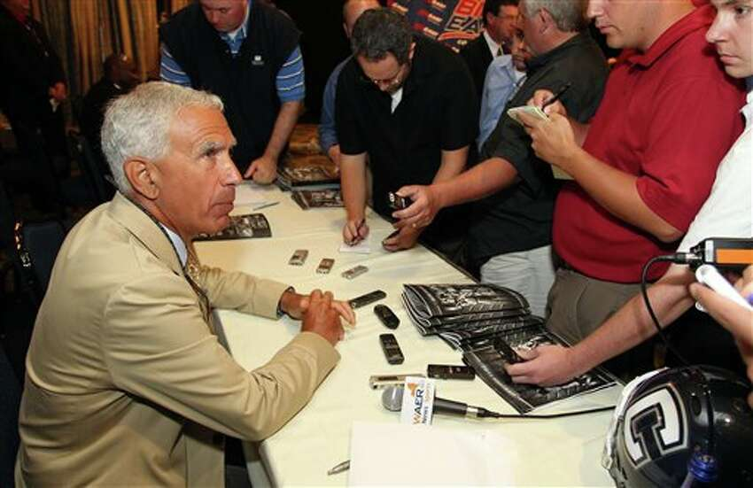 Connecticut head football coach Paul Pasqualoni speaks to the media during the Big East football media day Tuesday, Aug. 2, 2011, in Newport, R.I.. (AP Photo/Stew Milne)
