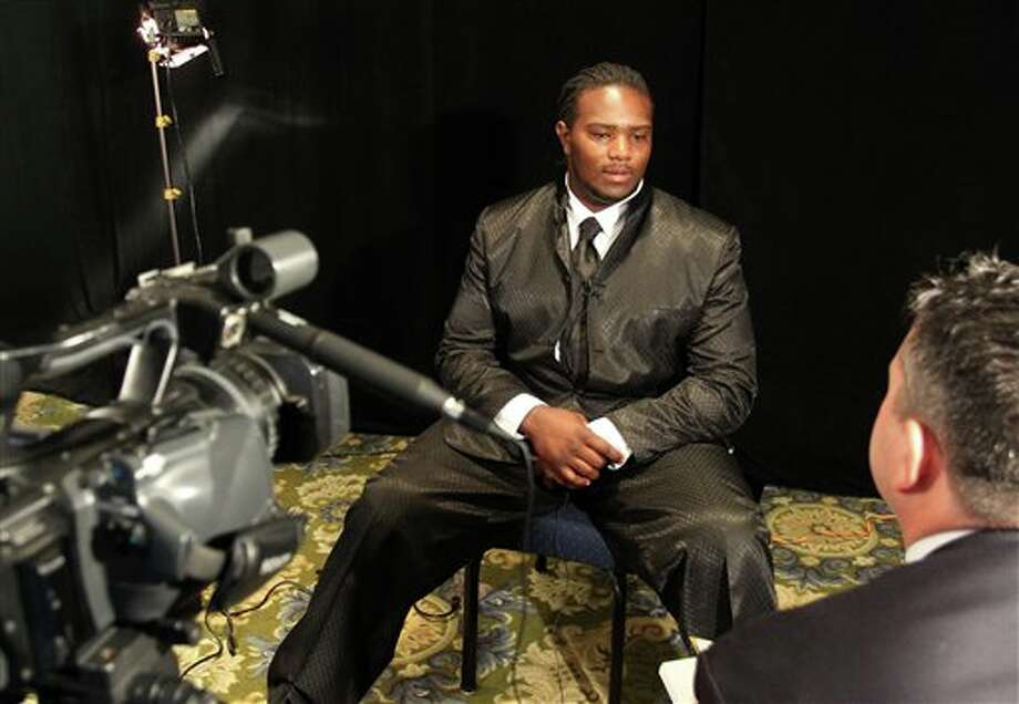 South Florida offensive guard Jeremiah Warren answers questions during a television interview during the Big East football media day Tuesday, Aug. 2, 2011, in Newport, R.I.. (AP Photo/Stew Milne) Photo: AP