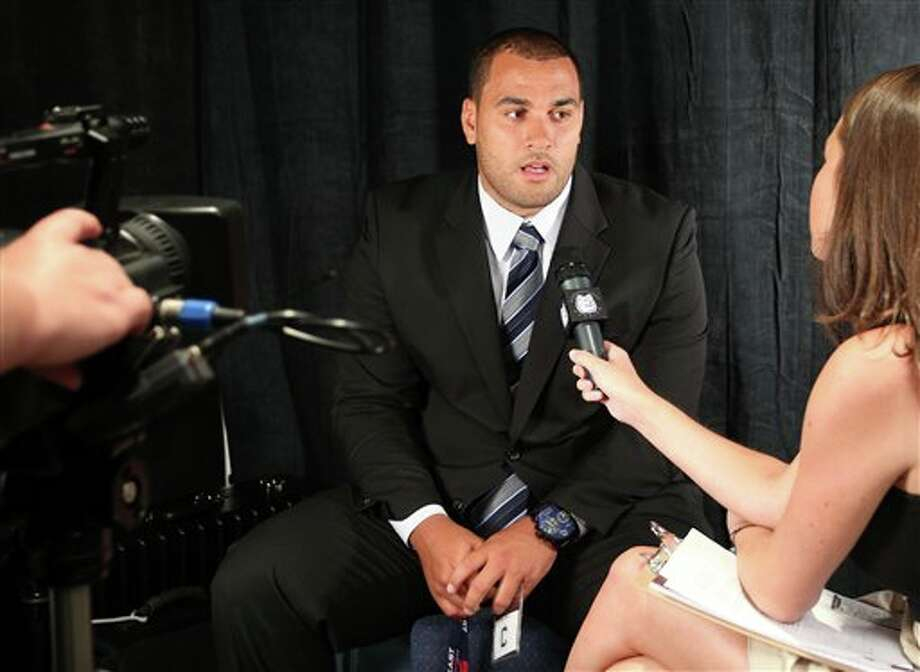 Connecticut center Moe Petrus answers questions during a television interview during the Big East football media day Tuesday, Aug. 2, 2011, in Newport, R.I.. (AP Photo/Stew Milne) Photo: AP