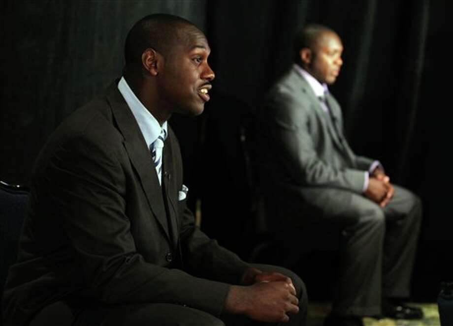 Syracuse defensive end Chandler Jones, left, and running back Antwon Bailey, right, answer questions during television interviews at the Big East football media day Tuesday, Aug. 2, 2011, in Newport, R.I.. (AP Photo/Stew Milne) Photo: AP