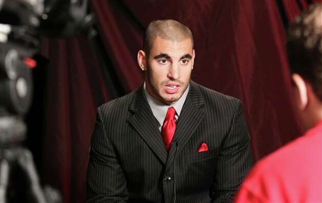 Rutgers running back Joe Martinek answers questions during a television interview at the Big East football media day, Tuesday, Aug. 2, 2011, in Newport, R.I.. (AP Photo/Stew Milne) Photo: AP