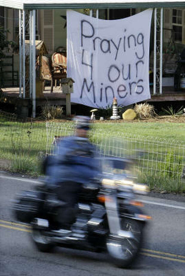 A sign expressing hope for coal miners hangs at a home in Montcoal, W.Va., on Tuesday. Photo: Mark Humphrey, AP