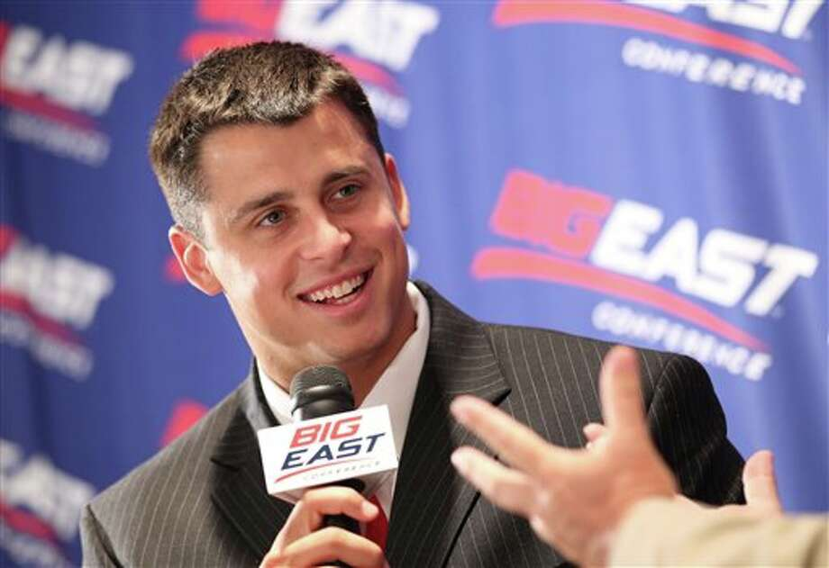 Cincinnati quarterback Zach Collaros answers questions during a television interview at Big East football media day, Tuesday, Aug. 2, 2011, in Newport, R.I.. (AP Photo/Stew Milne) Photo: AP