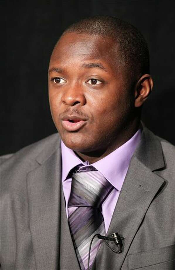 Syracuse running back Antwon Bailey answers questions during a television interview at Big East football media day Tuesday, Aug. 2, 2011, in Newport, R.I.. (AP Photo/Stew Milne) Photo: AP