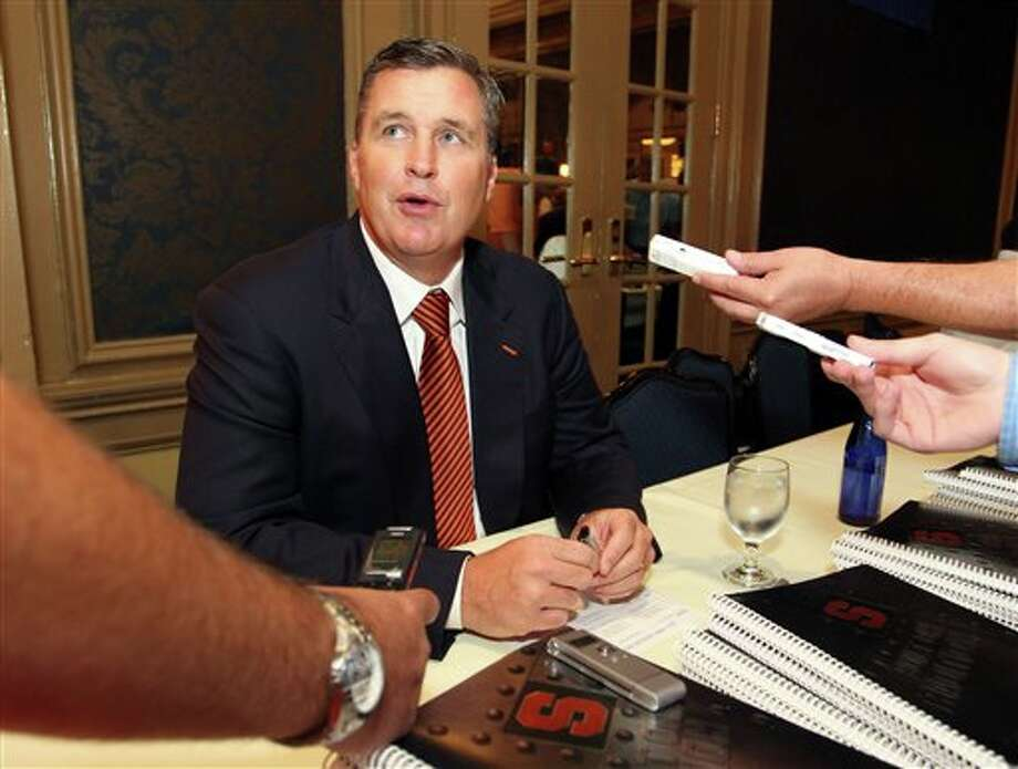 Syracuse head football coach Doug Marrone speaks to the media during the Big East football media day Tuesday, Aug. 2, 2011, in Newport, R.I.. (AP Photo/Stew Milne) Photo: AP