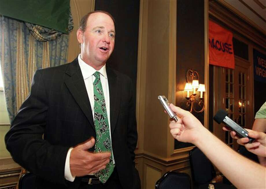 South Florida head football coach Skip Holtz speaks to the media during the Big East football media day Tuesday, Aug. 2, 2011, in Newport, R.I.. (AP Photo/Stew Milne) Photo: AP