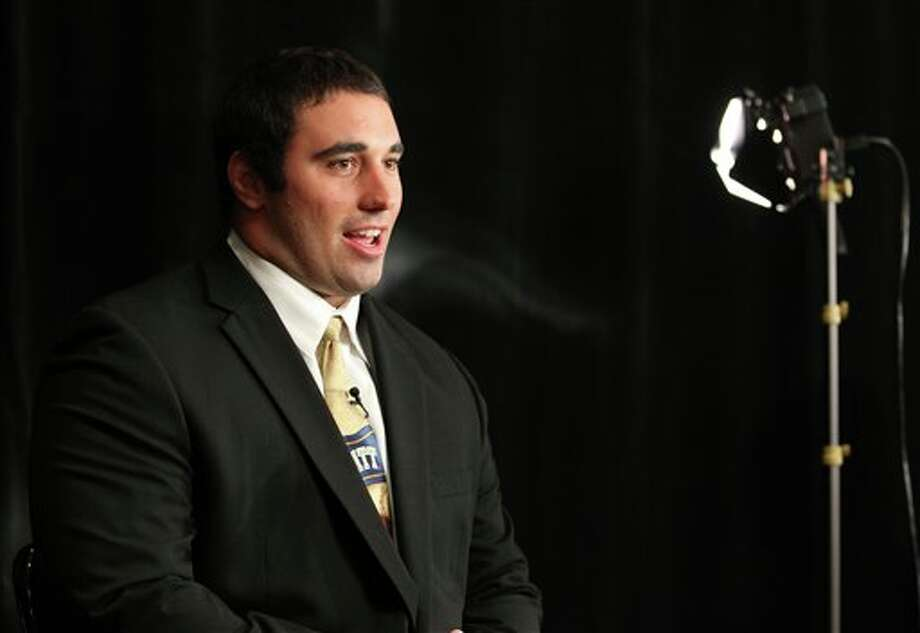 Pittsburgh defensive tackle Myles Caragein answers questions during a television interview during the Big East football media day Tuesday, Aug. 2, 2011, in Newport, R.I.. (AP Photo/Stew Milne) Photo: AP