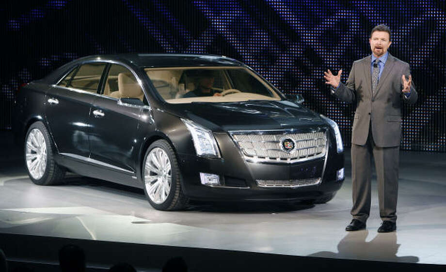 Cadillac Design Director Clay Dean unveils the Cadillac XTS Platinum concept at the North American International Auto Show in Detroit. Photo: Wieck