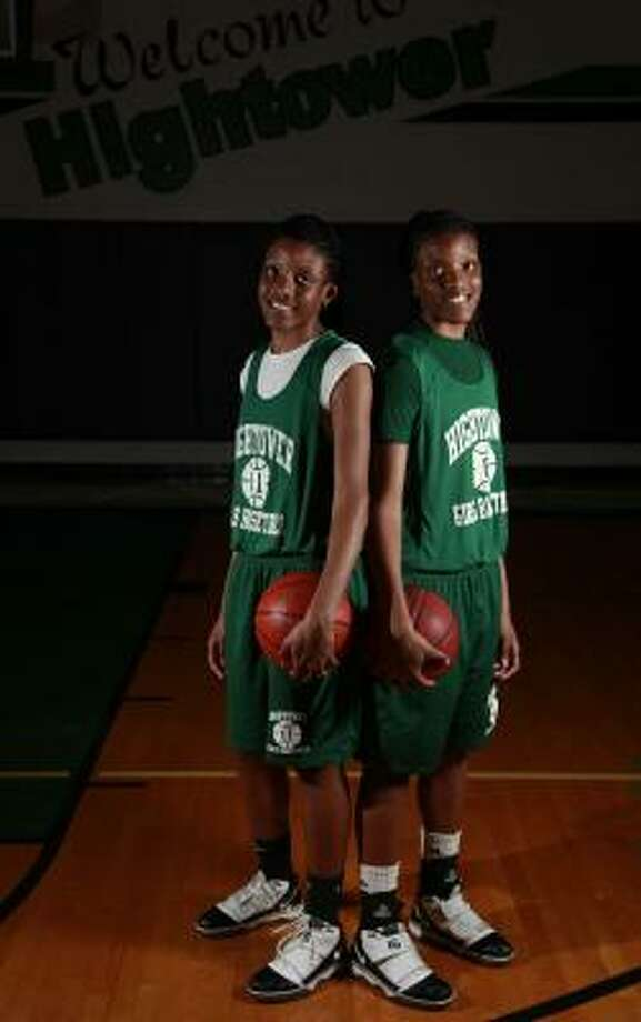 Twin sisters Taylor and Tyler Gilbert have led Hightower to the state semifinals. Photo: Mayra Beltran, Chronicle
