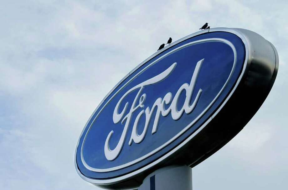 In this photo taken July 24, 2011, the Ford logo is displayed at an auto dealership in Springfield, Ill. Ford Motor Co. said Tuesday, Aug. 2, 2011, its U.S. sales rose 6 percent in July, boosted by small cars and SUVs. (AP Photo/Seth Perlman) Photo: Seth Perlman, STF / AP