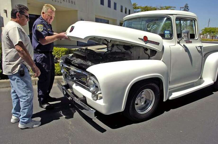 California Highway Patrol officer Greg Bennett and Harold Voelker inspect Voelker's 1956 Ford F-100 truck in Modesto, Calif. The pickup was stolen from Voelker in 1972. Photo: Joan Barnett Lee, AP