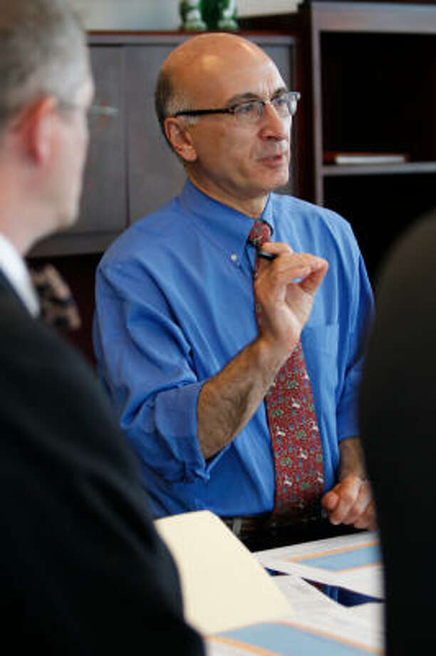 Among other things, George Greanias is known for conducting meetings at Metro headquarters with participants standing, rather than sitting, around a tall square table. Photo: Melissa Phillip, Chronicle