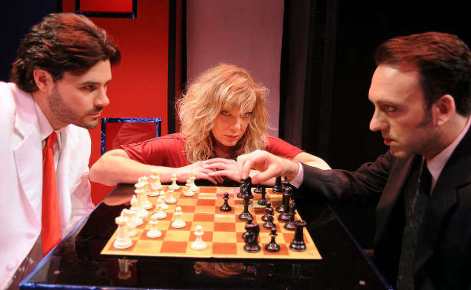 Florence (Rebekah Dahl) watches the action as American champ Freddie (Brad Scarborough, left) and Russian champ Anatoly (Luther Chakurian) battle it out in Masquerade Theatre's production of Chess. Photo: Dave Rossman, For The Chronicle