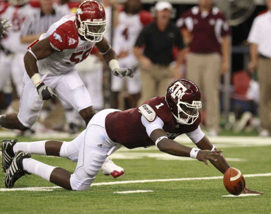 Quarterback Jerrod Johnson (1) and Texas A&M will take a two-game losing streak into Saturday's game against Missouri. Photo: MICHAEL AINSWORTH, The Dallas Morning News