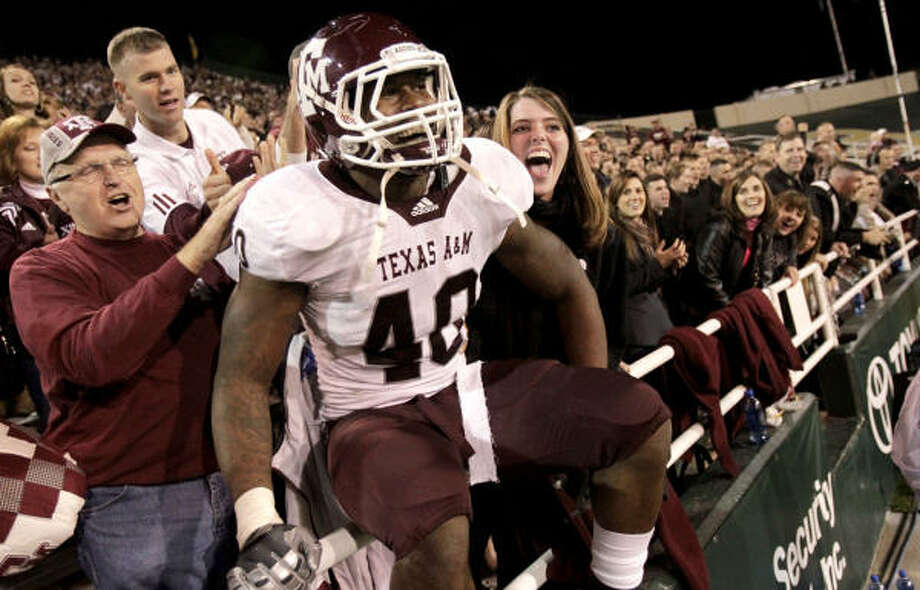 Texas A&M's Von Miller has a chance to lead his resurgent team to six straight victories to close out the regular season Photo: Julio Cortez, Houston Chronicle