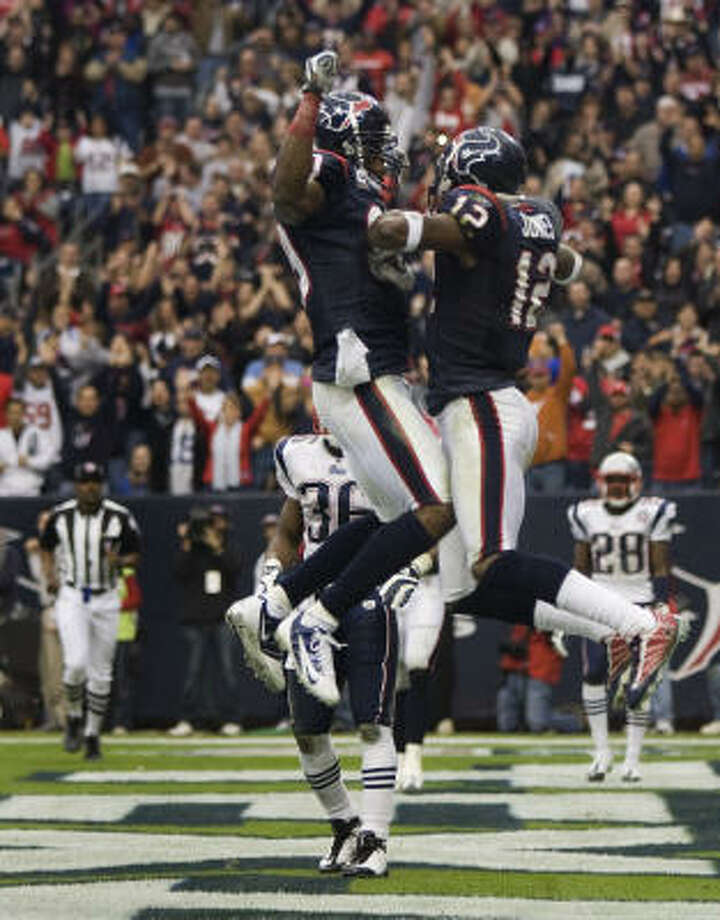 Texans wide receiver Andre Johnson (80) and Jacoby Jones (12) celebrate Jones' eight-yard touchdown reception. Photo: Brett Coomer, Chronicle