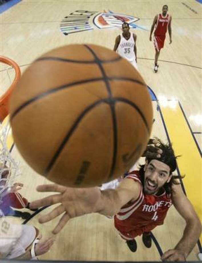 Rockets forward Luis Scola finished with 25 points and six rebounds. Photo: Sue Ogrocki, AP