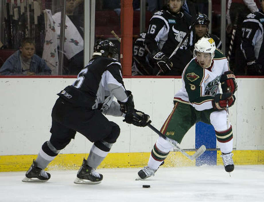 Cal Clutterbuck, right, developed into a key player for the Wild after his time with the Aeros. Photo: Bob Levey, For The Chronicle