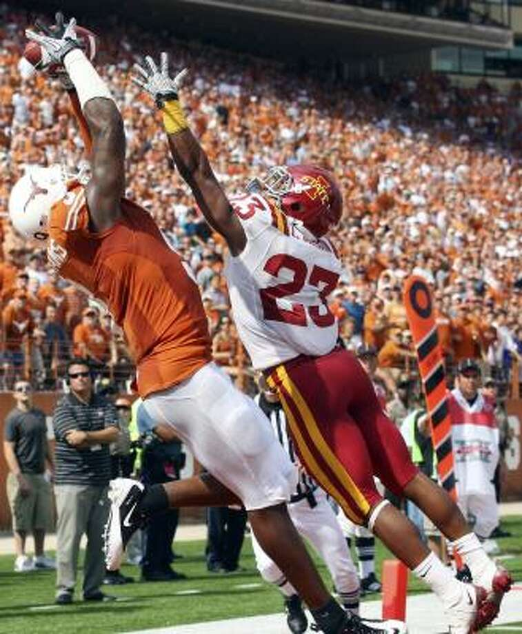 Wide receiver Malcolm Williams, left, and the Longhorns are happy to be on the road again. Photo: EDWARD A. ORNELAS, SAN ANTONIO EXPRESS-NEWS