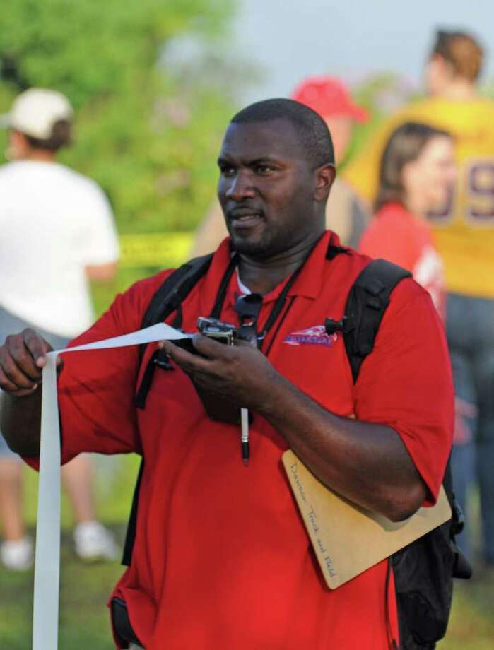 Dawson boys cross country coach Vincent Hypolite during the 2010 season that included a District 24-4A team title. Hypolite hopes his team can repeat as district champs in 2011. Photo: L. Scott Hainline / freelance