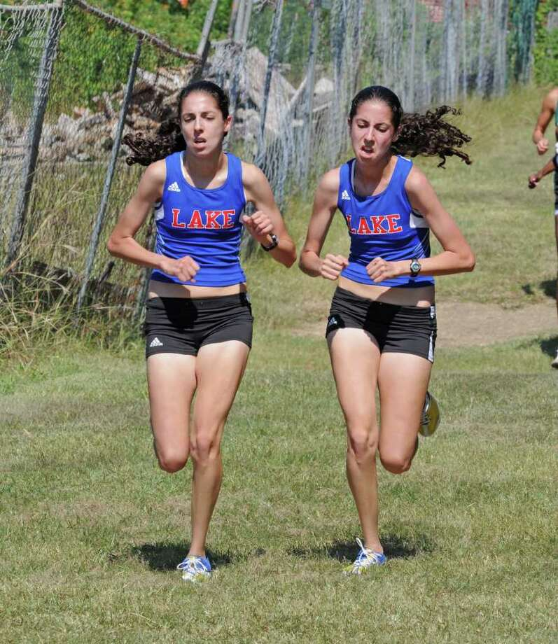 L. SCOTT HAINLINE: FOR THE CHRONICLE DOUBLE TROUBLE: Clear Lake girls cross country 2011 seniors Chrissy Wassef, left, and twin sister Audrey Wassef have each won this season in the first two meets of the season. Photo: L. Scott Hainline / freelance