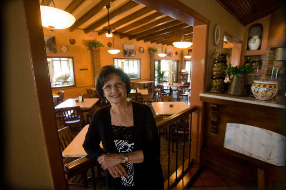 BY DESIGN: Mary Mandola selected many of the antiques, furniture, and decor for the Nino's, Vincent's and Grappino di Nino restaurants, which she and husband Vincent Mandola own. Photo: R. Clayton McKee, For The Chronicle