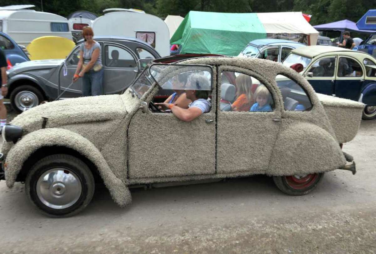 People from the Netherlands drive their customized Citroen 2CV car on July 27, 2011 in Salbris, France during the 19th World meeting of 2 CV Friends.
