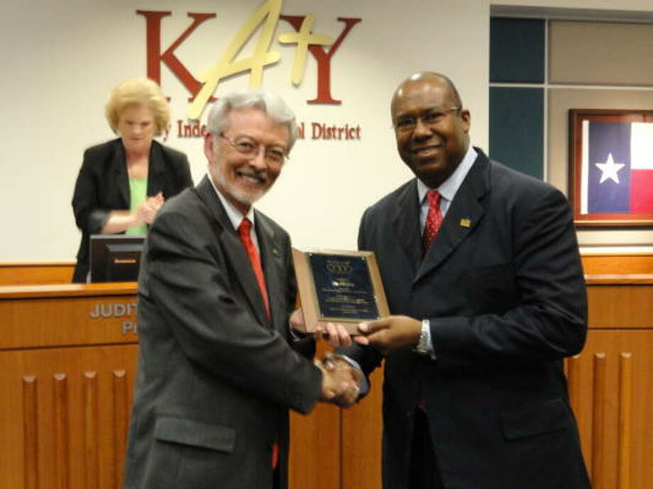 REGIONAL AWARD: Bill McKinney, left, executive director of Region 4, recognizes Alton Frailey, Katy ISD superintendent, as regional superintendent of the year.