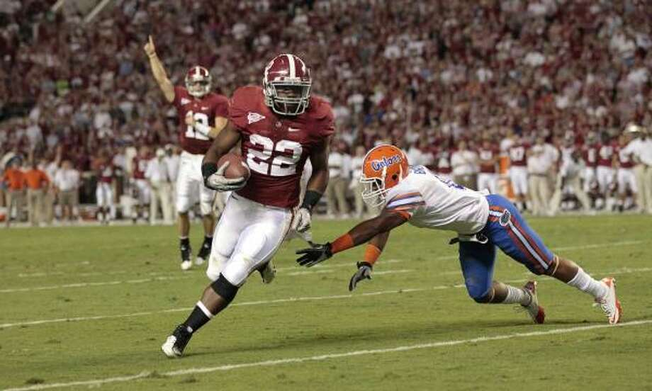 Mark Ingram and Alabama ran over SEC rival Florida on Saturday. Photo: Dave Martin, AP