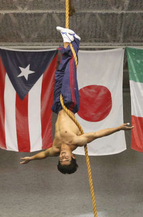 Raj Bhavsar works out at Houston Gymnastics Academy on Thursday in Houston. At 30, his career as a competitive gymnast has run its course, but a new one is on the horizon. Photo: Melissa Phillip, Chronicle