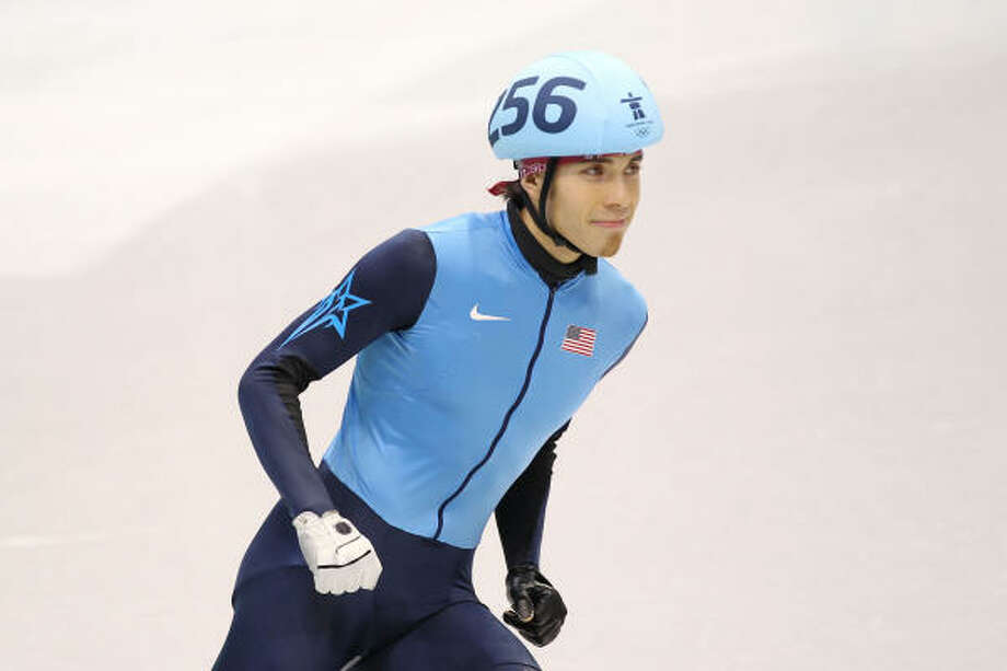 Apolo Anton Ohno broke a tie with Bonnie Blair by winning a bronze in the 1,000-meter short track, making him the winningest U.S. Winter Olympian. Photo: Jamie Squire, Getty Images