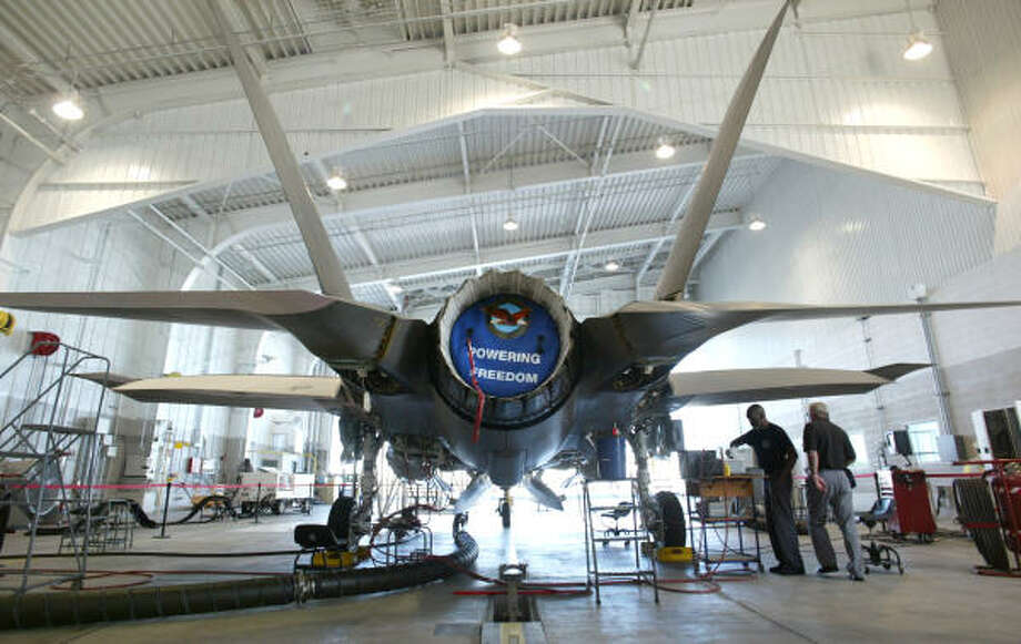Lockheed Martin reported lower earnings Tuesday and they may go lower after Britain reduced its order for the F-35 Joint Strike Fighter, which is built in Fort Worth. Photo: M.L. Gray:, Fort Worth Star-Telegram