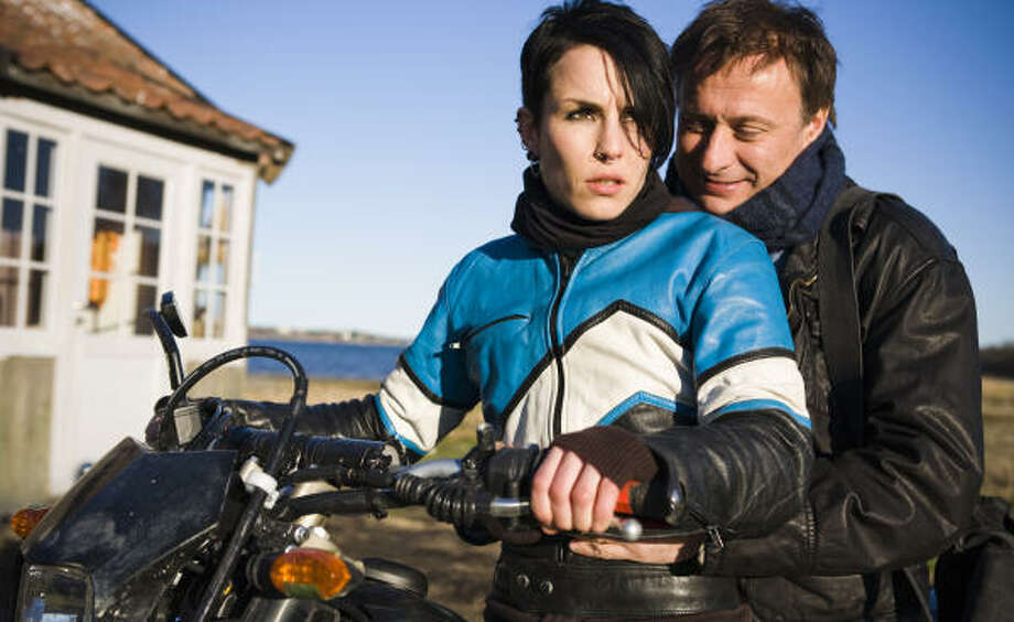 Lisbeth Salander (Noomi Rapace) and Mikael Blomkvist (Michael Nyqvist) star in The Girl With The Dragon Tattoo. Photo: Knut Koivisto