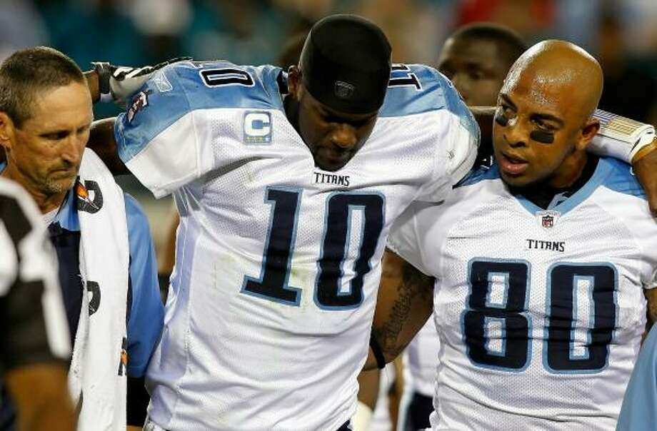 Titans quarterback Vince Young is helped from the field during the first quarter on Monday night. Photo: J. Meric, Getty Images