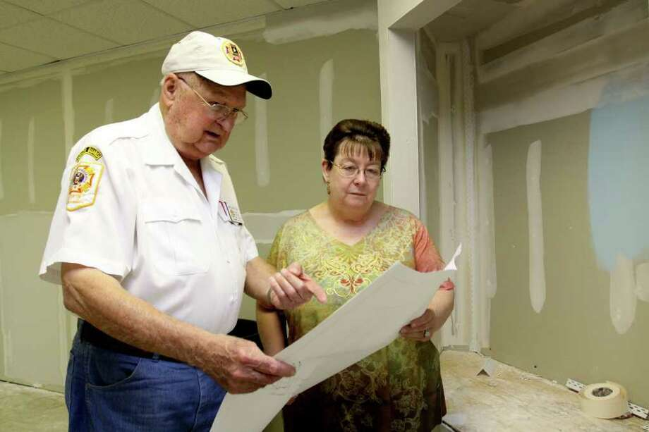 Katy Veterans Memorial Museum at 6206 George Bush Drive is doubling its size of the display area and adding an office for the museum director, Norris Miertschin.  The DPS moved out of the location, freeing up new space for the museum to expand.  Norris Miertschin, museum director and Betty Edmuson, museum administrator, examine blueprints of the new display room.  Suzanne Rehak/For the Chronicle Photo: Suzanne Rehak, Freelance Photographer