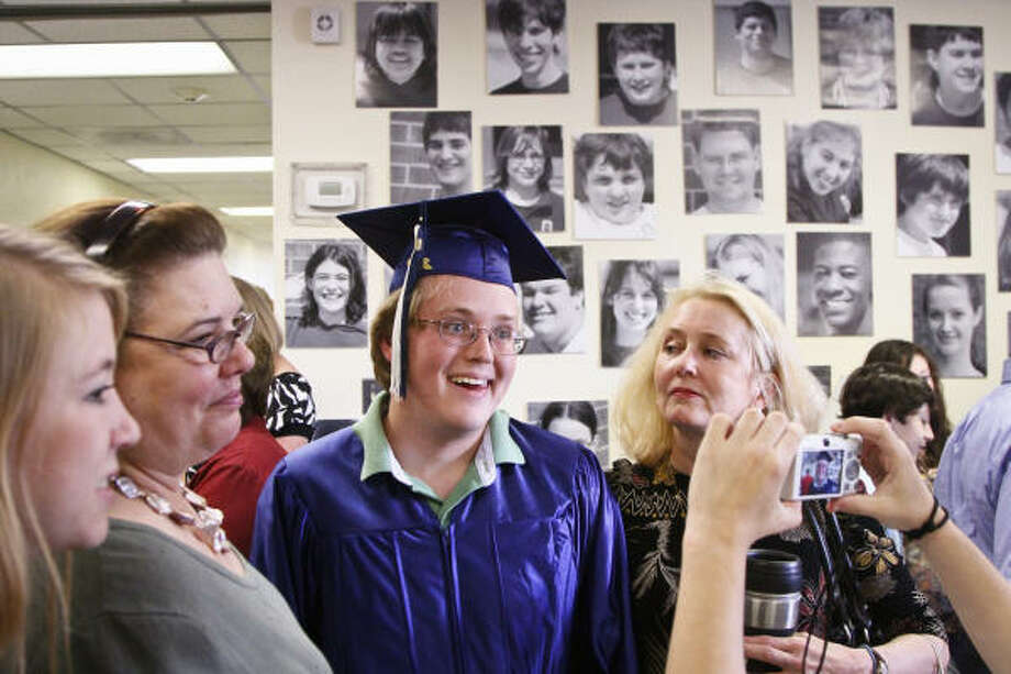 John Paul Golvach has his photo snapped after graduating Friday along with five other students at Gateway Academy. Photo: Michael Paulsen, Chronicle