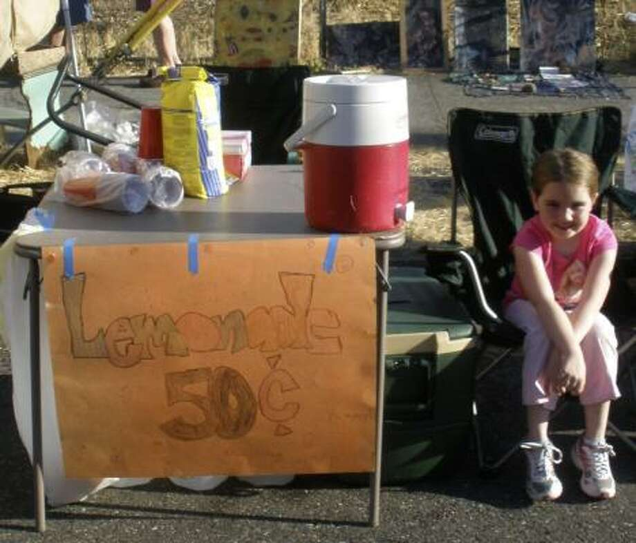 Julie Murphy, 7, shown at her lemonade stand in Portland, had to pack it up at an arts fair when a county inspector found she and her mother didn't have a restaurant license. Photo: Maria Fife